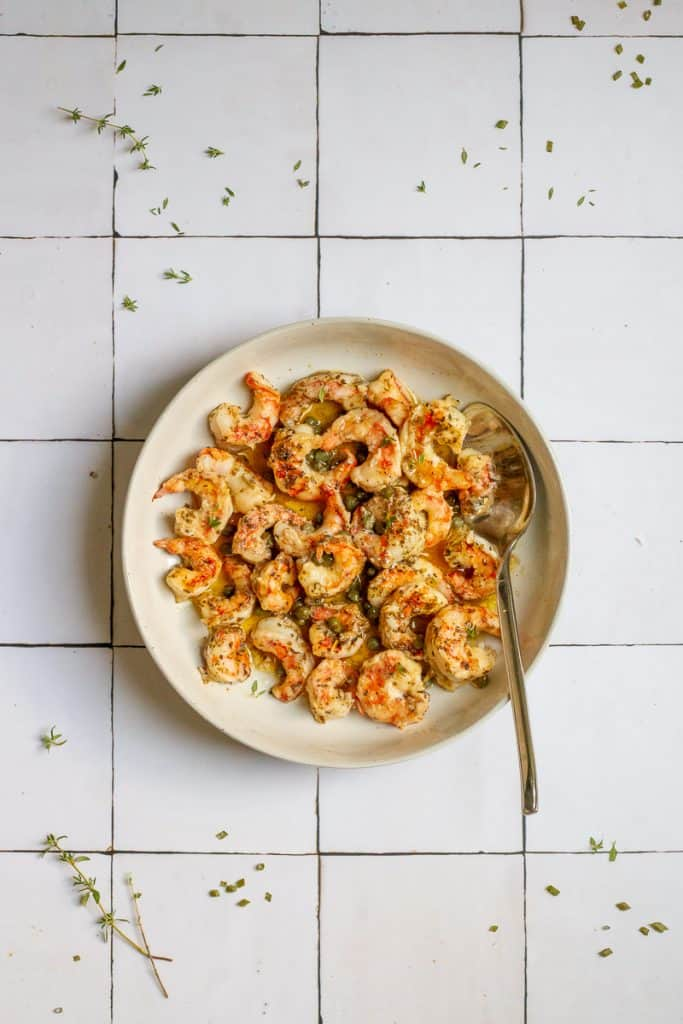 spot prawn recipe served with butter sauce in serving bowl.