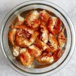 spot prawns in a bowl to defrost.